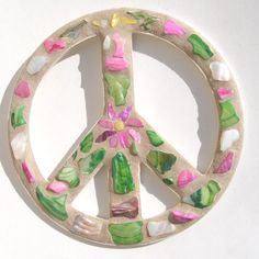 tps://www.etsy.com/listing/498777968/shell-peace-sign-wall-art-beach-decor?ref=pr_shop … #peacesign #hippie #boho #flowerpower #beachdecor #FEOteam #EtsyTeamUnity