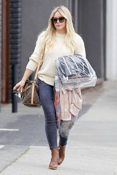 Hilary Duff wearing Parker Smith Bombshell Crop Jeans in Volcan and Louis Vuitton Speedy Bandouliere 30 World Tour