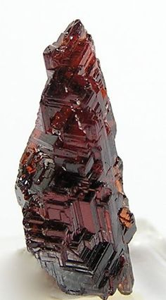 Red Spessartine Garnet Natural Etched Crystal. Red is the color of blood, and as such has strong symbolism as life and vitality. It brings focus to the essence of life and living with emphasis on survival. Red is also the color of passion and lust.