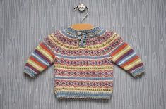 Free Pattern - This classic pullover silhouette is soft and warm next to baby's skin and is sure to be worn often. Choose a gender neutral palette as shown or choose a color scheme that emphasizes either the pink or blue shades of Cerro. Worked from the bottom up, the stranded colorwork body is worked in the round and the striped sleeves are worked flat. The body and sleeves are then joined for the yoke and the sweater is completed in one piece to neck.
