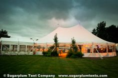 19. WAITING FOR THE GUESTS: The lights are on and the tent is ready to receive those lucky guests. This sailcloth tent has a marquee leading guests into the action.