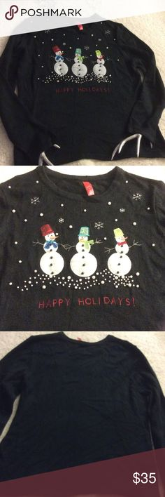 "NWOT Ugly Christmas Snowman Sweater Fits 16-18 NWOT Ugly Christmas Snowman Sweater Fits 16-18 Scene of three snowmen with lots of faux pearls. Black acrylic sweater. 48"" at chest, 29"" long from shoulder, 19"" between shoulders and arms are 26"" long. The back is plain. Made in China unbranded Sweaters Crew & Scoop Necks"