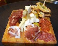 Antipasto Platter with Italian meats, three Italian cheeses, Roman artichoke heart, Prosciutto and Provolone stuffed cherry pepper and olives. DELICIOUS!