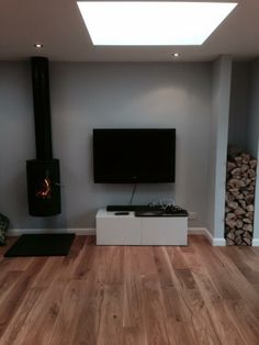 Can you spot the beautiful stove in this picture? It's the Westfire Unique 21Wall hung stove. Shop online @ http://www.woodburners.co.uk/_-Westfire-Uniq-21-Stove-_/product/?pid=11808