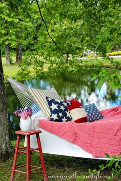 Happy Memorial Day, hammock, red,white and blue, vintage quilts, Pottery Barn pillows, vintage stool, pond, summer