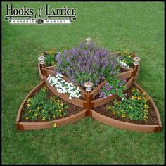 raised garden beds. Love this geometric flower shape. Would be a beautiful centerpiece for an herb garden.
