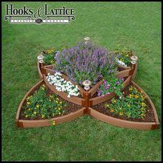 raised garden beds. Love this geometric flower shape. Would be a beautiful centerpiece for an herb garden.