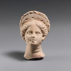 Terracotta female head,late classical o hellenistic period,4th century BC  Greek