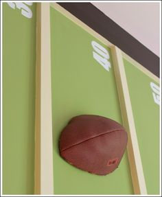 Again, the football and baseballs mounted on the cornice board were cut in half.  There are so many different ideas you could do using sports equipment! Make a whole wall collage of baseballs. Or spell out your child's name in baseballs cut in half.