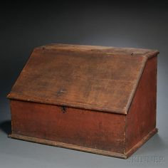 Red-painted Pine Desk Box, New England, first half 18th century, the molded top above the slant-lid on a dovetail-constructed box, the lid opens to a well and divided shelf, all on a molded base, original surface