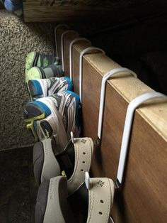 RV shoe storage idea: over door hooks along side of bed #rvtips