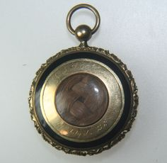 1836 locket - with the loved one's hair under the glass portion.