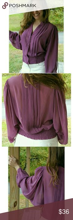 Hinge Burgundy Top Super cute and romantic, this top will look great with a pair of high-waisted skinny jeans for that movie afternoon/evening kind of affair or pair it with a white flow-look skirt for a  more formal event.  Dress up, dress down, you can't go wrong with this gorgeous piece! Details to the loose style sleeves and pleats on the front and the back.  Stunning! 100% Polyester. Berry-Amethyst color.  XS. Appr measurements: Bust 27, Arm length 24.5, Shoulder to shoulder 14,  Waist…