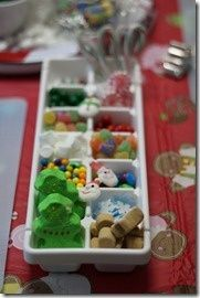 ice trays for each kid to get candy for the gingerbread house.  keeps the table clear of bowls of candy, and the candy stays more sanitary
