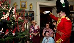 Camilla, Duchess of Cornwall meets some of the patients at Clarence House. December 2014