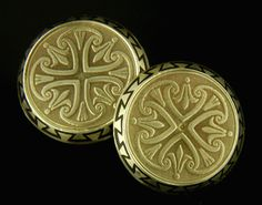 During the 19th and early 20th centuries,  jewelry and cufflink makers were often inspired by the arts and myths of ancient civilizations.  Lotus blossoms and stylized papyrus fronds grace these exuberant Egyptian Revival cufflinks.  With a bit of elegance worthy of a Pharaoh, the beveled edges of the cufflinks are accented with a dramatic meander traced in black enamel.  Crafted in 14kt gold, circa 1910.