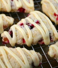"""Orange Glazed Cranberry Scones. Orange zest, cranberries, dried apricots, orange juice, powdered sugar. Previous pinner said """"They're soft, sweet and citrus-y. Not dense and bready like a lot of scones can be."""""""