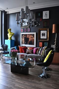 Love how they place art pieces on the wall. Love the eclectic feeling about it. Love bright yellow funky touches. Love the light fixture & lamp. Love how they dare to mix colors, textures, and styles. Love! Love! Love!