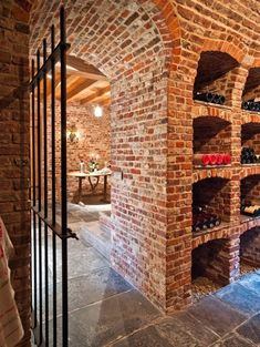 Exposed brick wine cellar with fantastic archways.