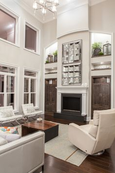 Chic high leg recliner in Living Room Transitional with White Fireplace Mantel next to Mirror Over Mantel alongside Two Story Living Room and Decorating Art Niches