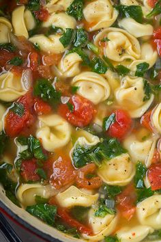 Fresh Spinach Tomato and Garlic Tortellini Soup - this soup is unbelievably delish! So much fresh and cheesy goodness!