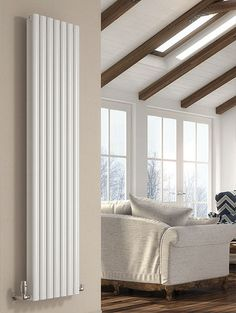 The DQ Cove Vertical Designer Radiator has a smooth and sleek design and is available in 3 stunning finishes: White, Black and Anthracite. Available in a single or double.