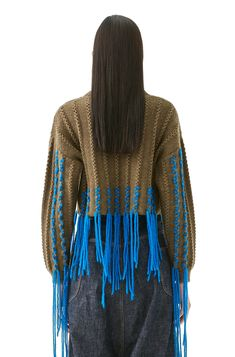 Knitted cropped sweater with contrast fringes stitched around the hem and sleeves Knitwear Fashion, Knit Fashion, Sweater Fashion, Fringe Fashion, Gothic Fashion, Pullover Mode, Embroidery Fashion, Sweater Embroidery, Fringe Sweater