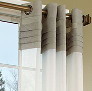 curtains - I just love the tucked detail under the grommets. With just sheers below.