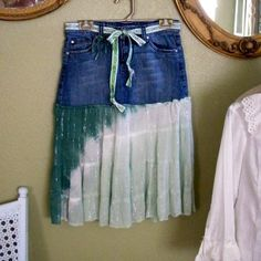 I should try this! It basically looks like a jean mini skirt sewed to the bottom of a flowery skirt with the top cut off. If that makes any sense?
