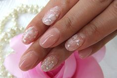 Nude and baby pearl pink flowers. Nail Art Manicure.