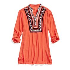 Orange Geometric tribal print top. Pictures just don't do this top justice. So pretty in person! I love to wear mine with black leggings in spring as a tunic, and skinny jeans in the Fall! Such a great top!