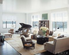 Vicente Wolf casual classic living room--white walls, neutral color palette, furniture layout, slipcovered sofa, baby grand piano