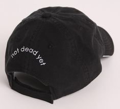 "ndy ""NOT DEAD YET"" Black Cap Giftwrapped, from ndy Not Done Yet on Etsy, $18.00"