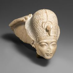 Head of Tutankhamun and a Hand of Amun, ca. 1336–1327 B.C. Egyptian. The Metropolitan Museum of Art, New York. Rogers Fund, 1950 (50.6) | Prior to the reign of Tutankhamun, Egypt had gone through great religious upheaval under Akhenaten, who promoted a single deity, the light god Aten. Tutankhamun restored the traditional worship of a multitude of gods and the supremacy of the god Amun, as illustrated by this sculpture.