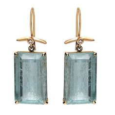 """These bold earrings feature dreamy, emerald-cut aquamarine gems with a petite diamond accent.    Gemstones:  diamond, aquamarine Metals:  14k yellow gold Length:  1.25"""" Handmade in USA    Item number:  240-02498"""