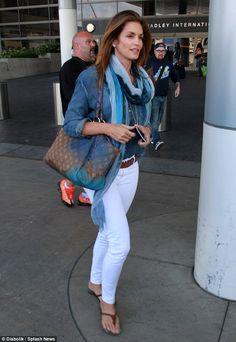 Brilliant in blue: The 49-year-old added a splash of colour thanks the blue-streaked scarf and blue-accented Louis Vuitton tote