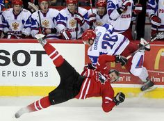 Russian player Ildar Isangulov collides with Canadian player Boone Jenner sending Jenner to the ice during second period of World Junior Hockey semi final action between the Canada and Russia at the at the Saddledome on Tuesday January 03, 2011 in Calgary.