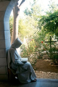 Monk reading by the cloister garden - Monastery Notre-Dame of the Assumption, Bet Gemal