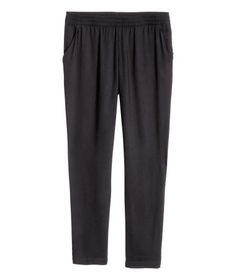 Black. Wide-cut pants in cool woven fabric with an elasticized waistband, tapered legs, and side pockets.
