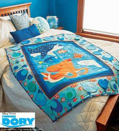 This interactive quilt, Hide & Seek Dory by Gina Reddin, is perfect for big and little kids who love the Disney movie Finding Dory ©Disney/Pixar! Lift up the flaps to reveal fun fish! Get the quilt kit while supplies last.