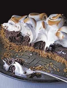 Girl Scouts-Inspired S'Mores Pie 5 large egg yolks 6 tbsp. sugar 3 tbsp. cornstarch, sifted ¼ tsp. fine sea salt 2 cups whole milk 1 tsp. pure vanilla extract 7 oz. bittersweet chocolate, melted 2 ½ tbsp. unsalted butter, cut into cubes, at room temperature 1 Graham Cracker Crust, prebaked For the marshmallow topping: 6 large egg whites ½ tsp. cream of tartar 1 ½ cups sugar 1 tsp. pure vanilla extract