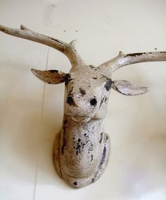 Wooden deer head at Andy Thornton ltd. by A M H 2010, via Flickr