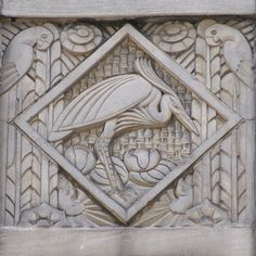 Art deco relief panel with heron and parrots on the Wacker Tower building on East Wacker Place in the downtown area of Chicago, Illinois.