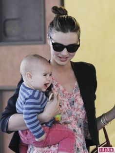 Miranda Kerr carrying her Baby