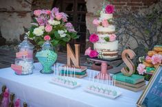 Gorgeous cake and decor at a bridal shower party! See more party planning ideas at CatchMyParty.com!