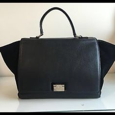 Kate spade trapeze bag Black trapeze bag. Very classy! Used a few times. In great condition. Light scratches on the  Kate spade hardware. Otherwise great condition! Comes with dust bag. kate spade Bags Satchels