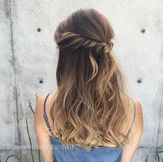 We love this half-up knotted style by Jenny Strebe of The Confessions of a Hairstylist​! She used #KenraPlatinum Dry Texture Spray to give the style more texture and fullness.