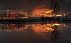 http://pixdaus.com/by-hudzik-roman-landscape-lake-sunset-trees/items/view/102662/