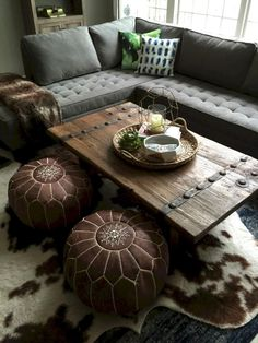 Adorable Boho chic with help from Home Goods! Sponsored The post Boho chic with help from Home Goods! Sponsored… appeared first on Home Decor For US . Bohemian Living Rooms, Home Living Room, Living Room Decor, Cow Hide Rug Living Room, Art Marocain, Pouf Cuir, Convertible Coffee Table, Coffee Table Inspiration, Floor Seating