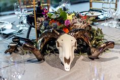 In the spirit of #Ubuntu, #iambecauseweare, the #ram #skull as a #centrepiece raise the question how do we collectively look after what give us life.  #Rialheim #Ceramics #reimagined #handcrafted #SouthAfrica #Themba #Gala #fundraising #dinner #celebration #floraldesign #botanical #theflowerartco #eventmanagement #eventinspo #dine #wine #art #pottery #dreambelievefly Ram Skull, Wine Art, Ceramic Decor, Centre Pieces, Event Styling, Fundraising, Floral Design, Celebration, Spirit